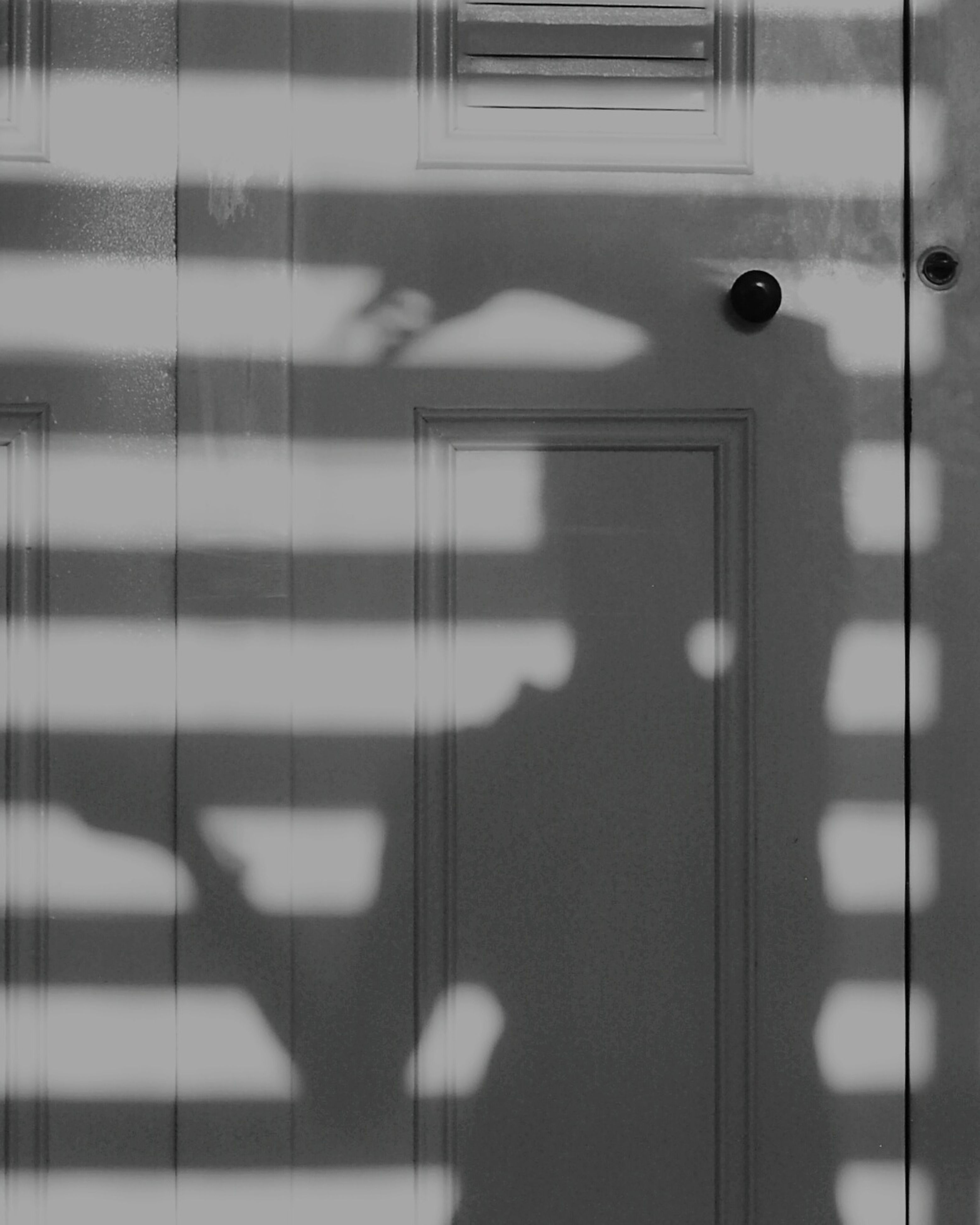 indoors, wall - building feature, built structure, architecture, illuminated, pattern, metal, lighting equipment, wall, no people, modern, reflection, flooring, railing, close-up, in a row, door, steps, shadow, white color
