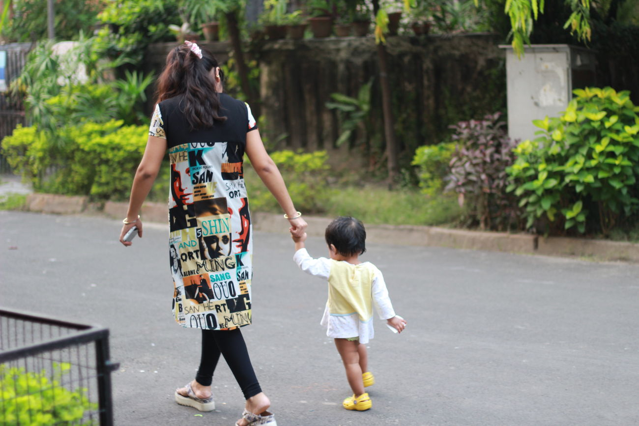 Snap A Stranger Two People Child Togetherness Childhood Casual Clothing Fun Full Length Bonding Happiness Friendship Outdoors People Females Real People Human Body Part Adult Day Motherhood Mother & Daughter Mother And Child Motherslove Streetphotography Strangers Motherlove