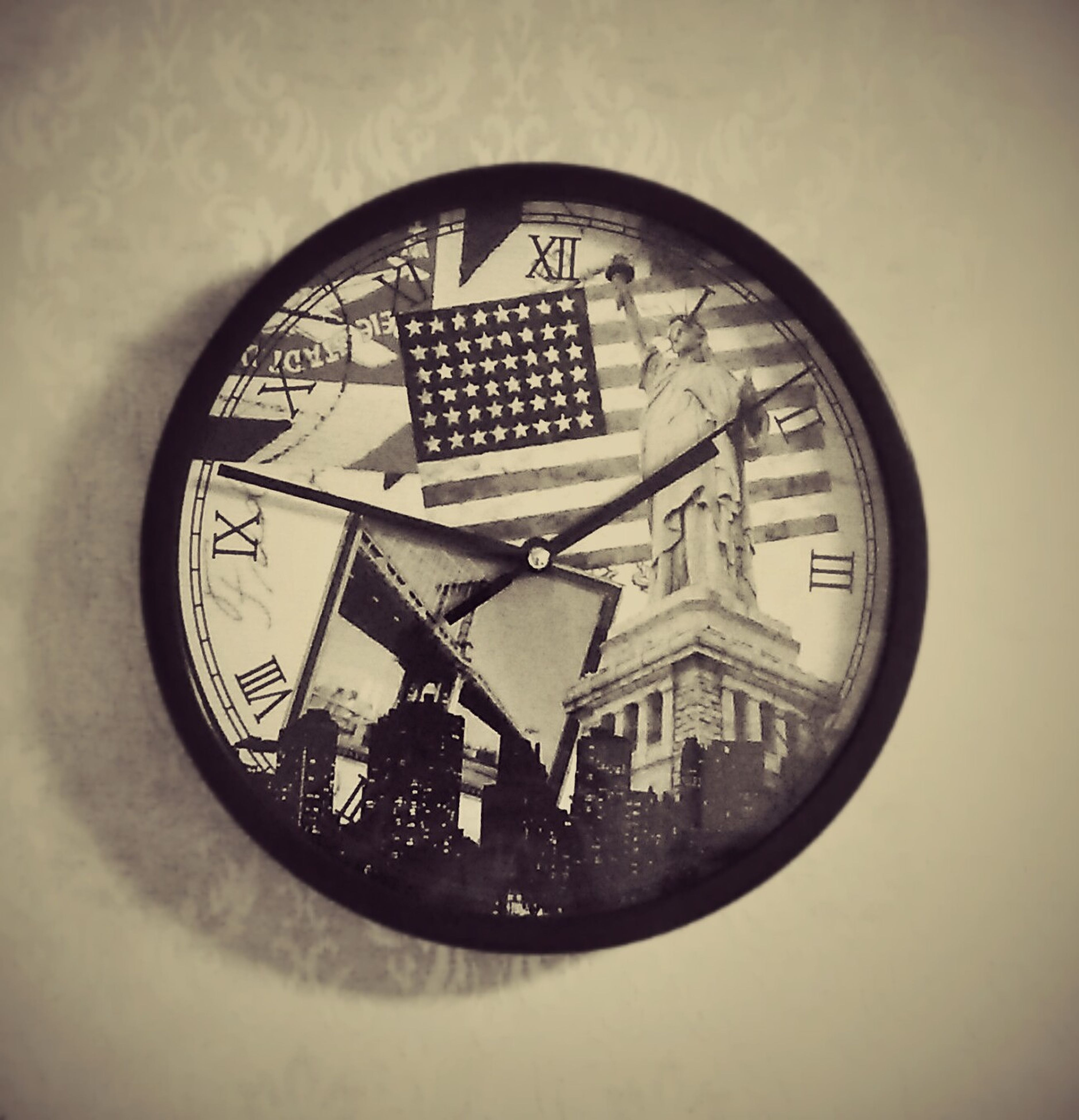 indoors, clock, time, circle, geometric shape, built structure, architecture, low angle view, clock face, number, old-fashioned, no people, window, roman numeral, wall - building feature, close-up, glass - material, minute hand, day, reflection
