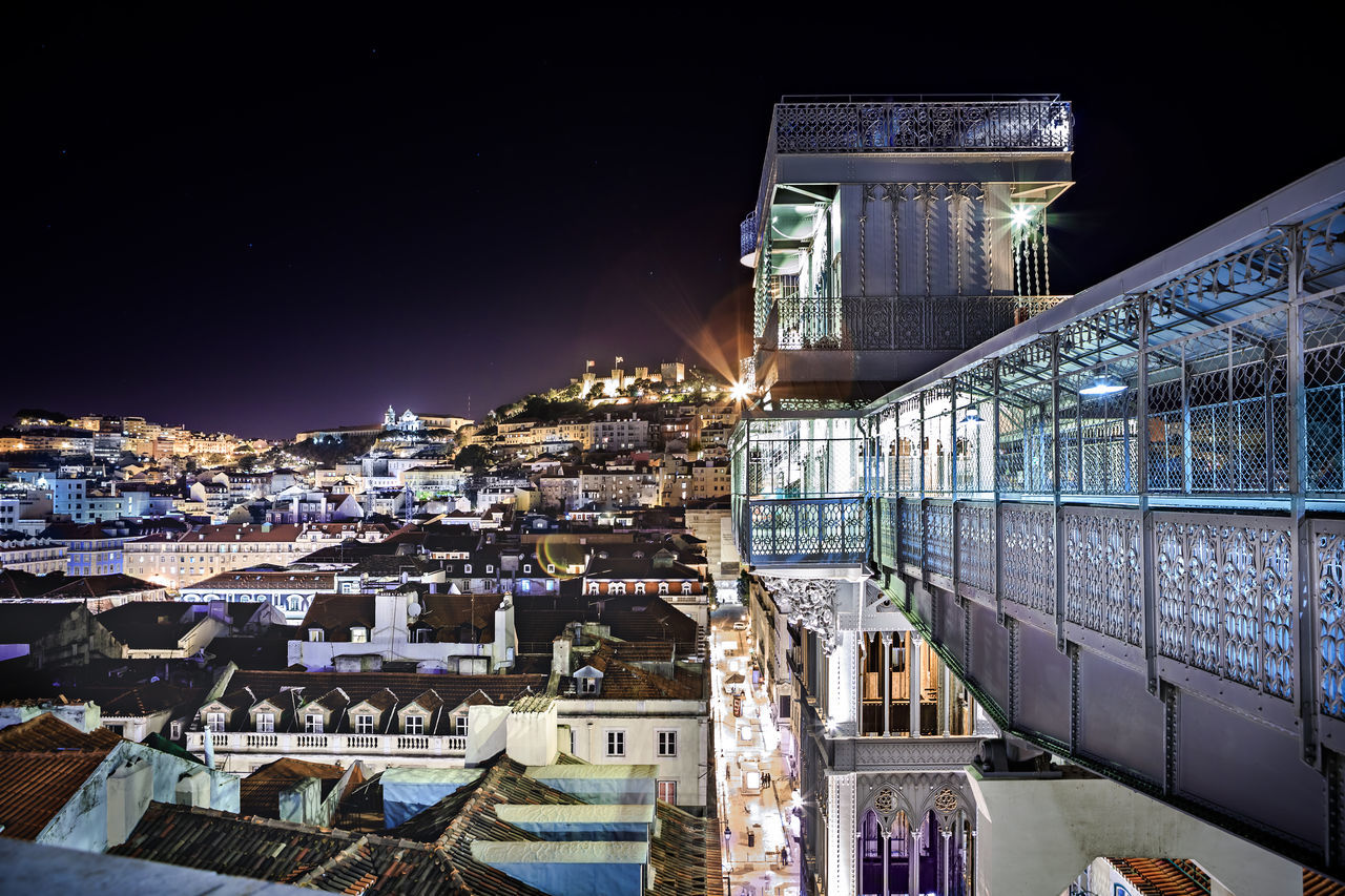 Elevador de Santa Justa in Lisbon town by night, Portugal Architecture Building Exterior Built Structure City Cityscape Clear Sky Elevador De Santa Justa, Architecture, Building, Castle, Editorial, Europe, Exterior, Famous, Formal, History, House, Lights, Lisbon, Night, Old, Palace, Park, Portugal, Public, Residential, Sightseeing, Street, Touristic, Tram, Travel Illuminated Modern Night No People Outdoors Residential Building Sky Skyscraper