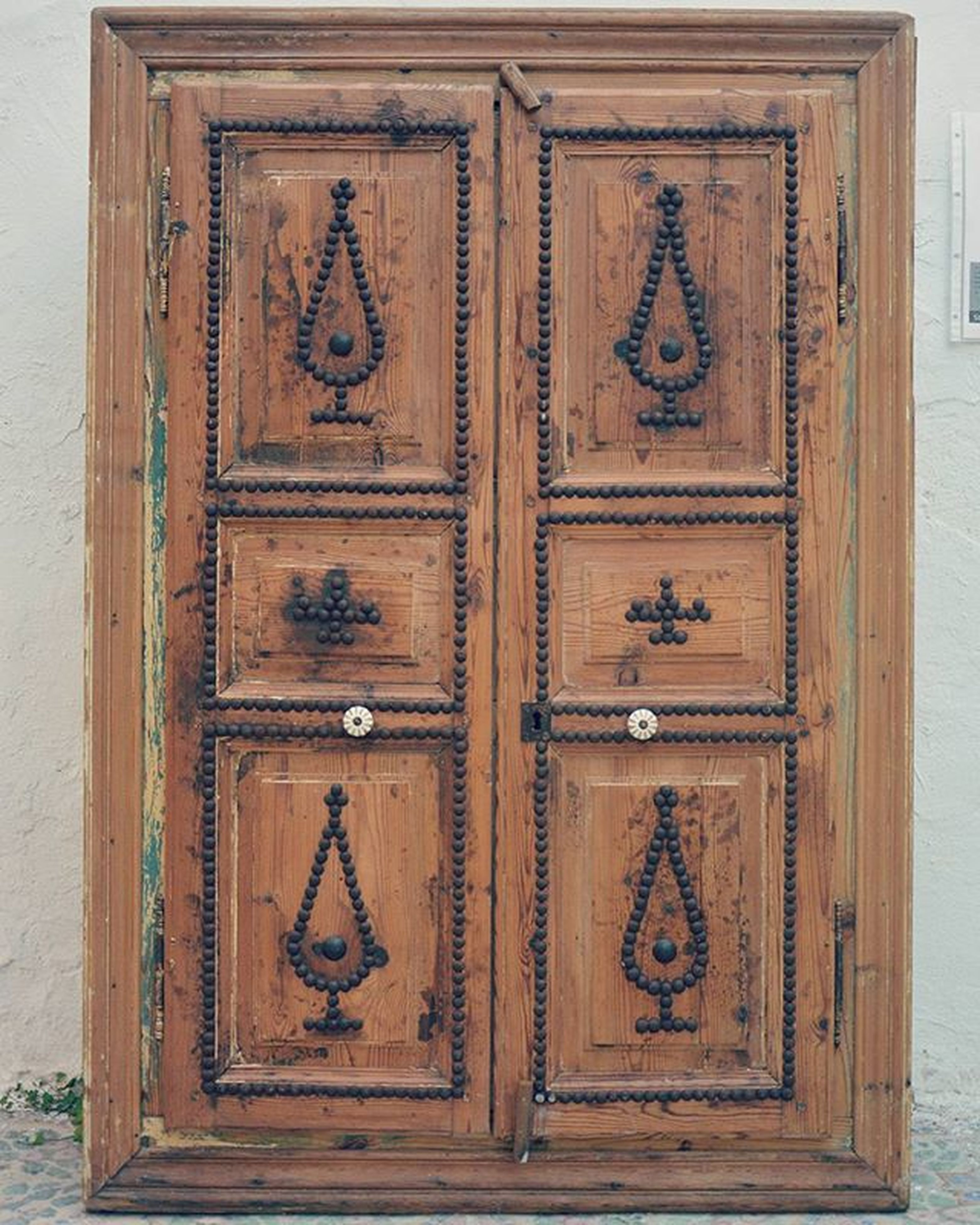 door, closed, built structure, building exterior, architecture, wood - material, wooden, safety, entrance, protection, security, wall - building feature, wood, close-up, metal, old, pattern, house, day, outdoors