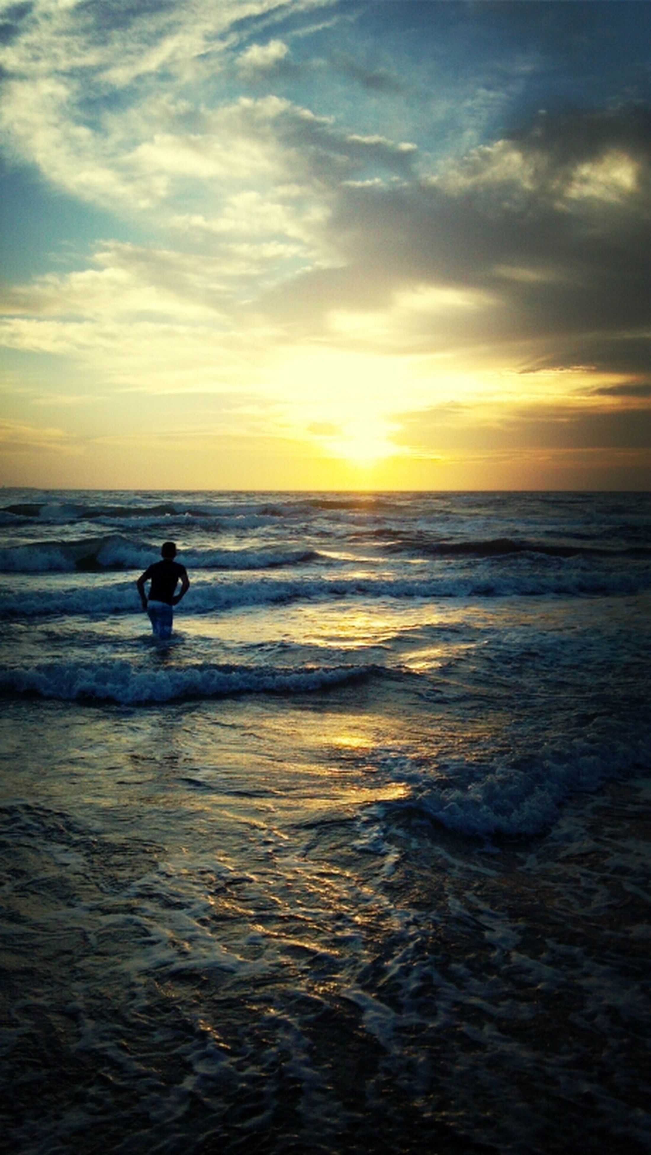 sunset, sea, water, horizon over water, sky, silhouette, scenics, beauty in nature, orange color, beach, wave, tranquil scene, leisure activity, lifestyles, men, tranquility, nature, idyllic