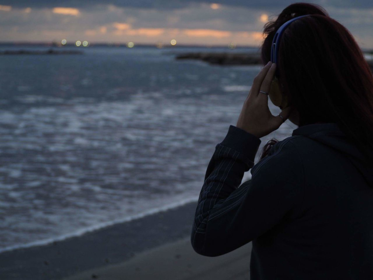 TakeoverMusic One Person Beach One Woman Only City Close-up Outdoors Nature Watching The Sunset Sunset Out Of Focus Background Listening To Music Headphones Hand Focus EyeEm EyeEm Nature Lover Limassol Cyprus