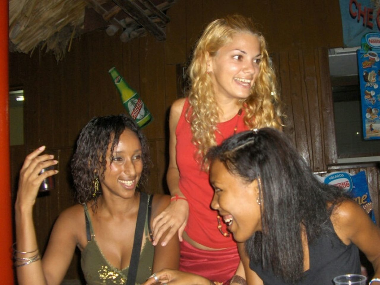 smiling, happiness, fun, cheerful, celebration, nightlife, enjoyment, night, indoors, laughing, adults only, party - social event, young adult, friendship, togetherness, long hair, young women, nightclub, people, adult, standing, headshot, blond hair, beautiful woman, portrait, women, human body part, clubbing, happy hour