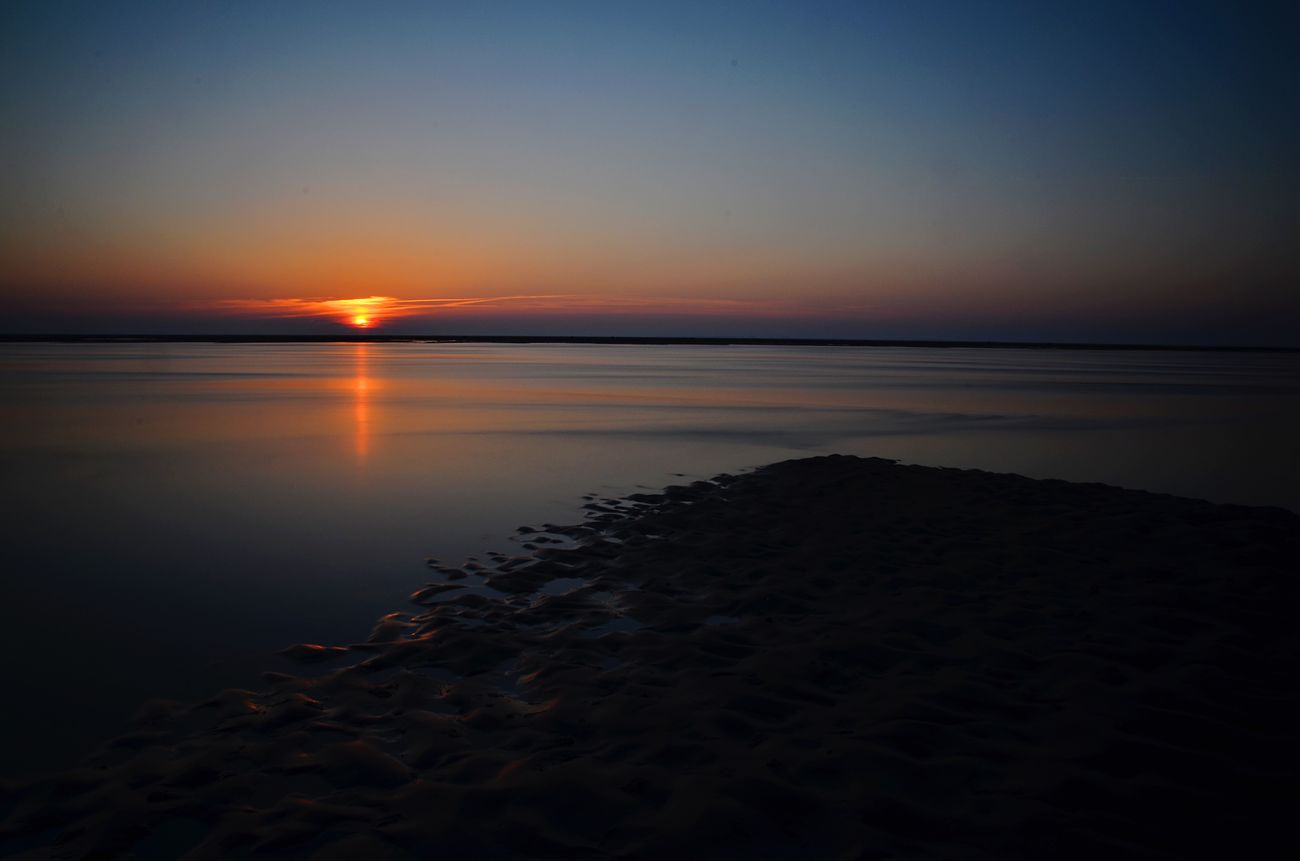 Sonnenuntergang auf Wyk auf Föhr Sunset Beach Beauty In Nature Scenics Tranquility Sea Tranquil Scene Nature Water Sky Reflection Idyllic Sand Horizon Over Water No People Outdoors Clear Sky Day