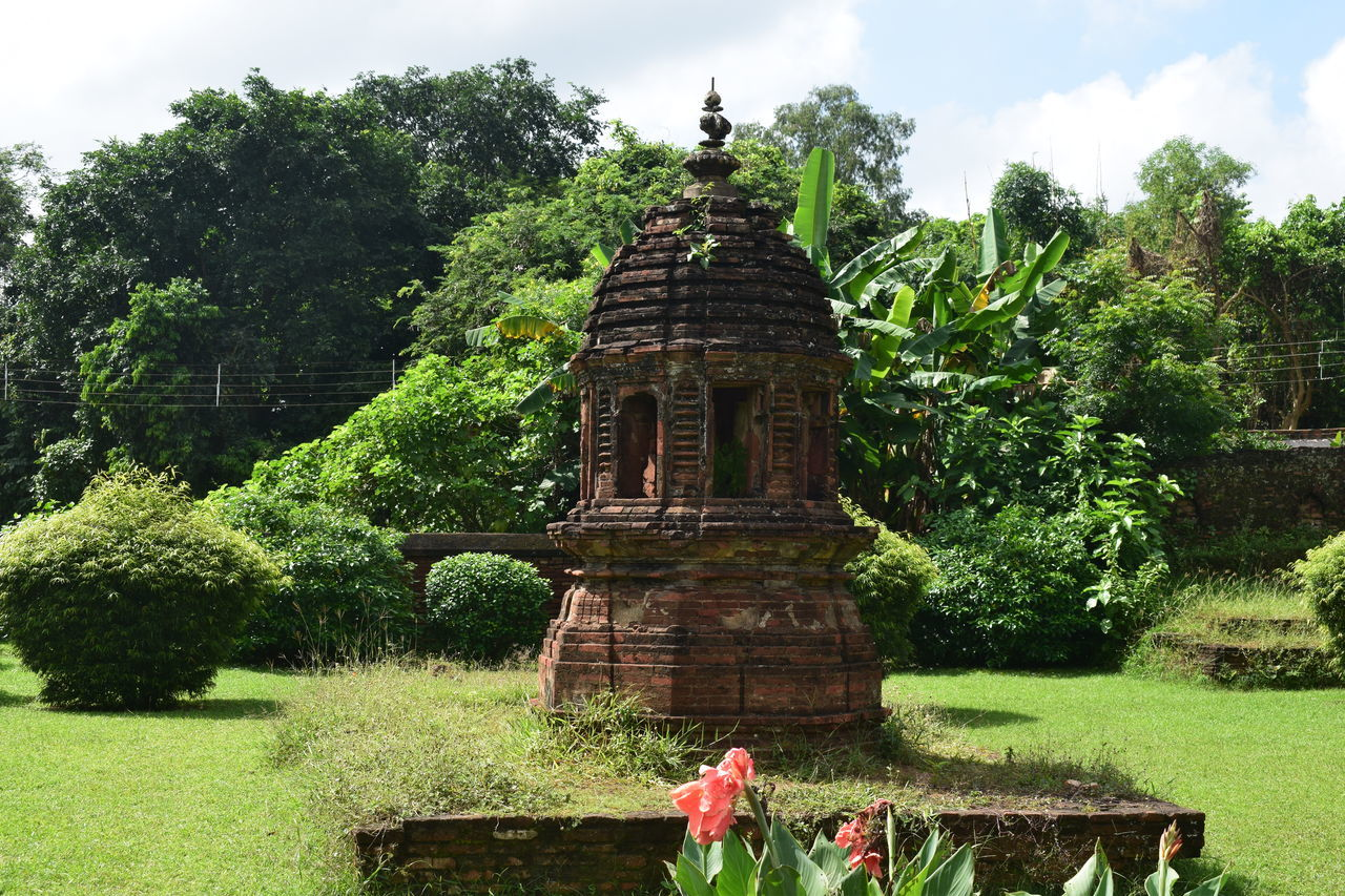 Tulsi Moncho: A temple for the Tulsi Plant, as built by the Malla Kings in Bishnupur, circa early 18th century. The Tulsi Mancha is unique in its appearance, looks like a temple by itself. The Tulsi plant is still living inside however no worship happens these days. It lives with wild chameleons. Bankura Bengal Hindu India Ancient Architecture Bishnupur Brick Burnt Orange History Religion Temple