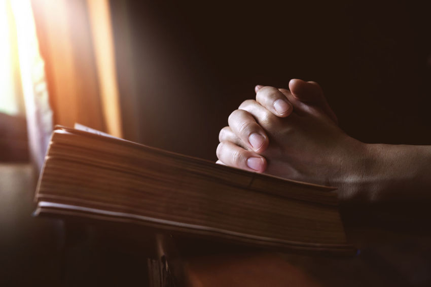 Christianity Church Bible Close-up Courtroom Day Gavel House Human Body Part Human Hand Indoors  Justice - Concept Law Legal System Legal Trial One Person People Praying Real People Window