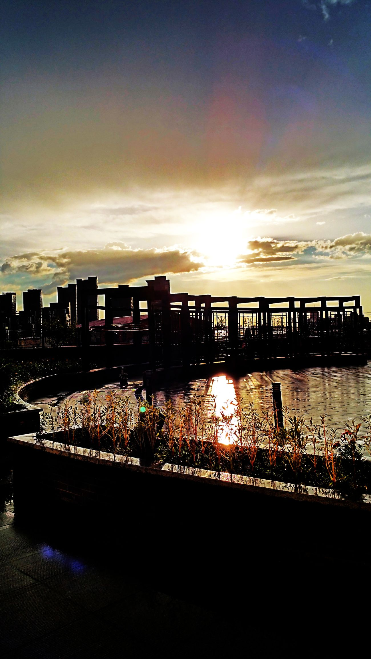A song from the horizon! Water City Building Exterior Architecture Sunset Built Structure Illuminated Cityscape Sky Reflection Cloud - Sky River Cloud Scenics Outdoors Waterfront Nature Tranquil Scene No People City Life