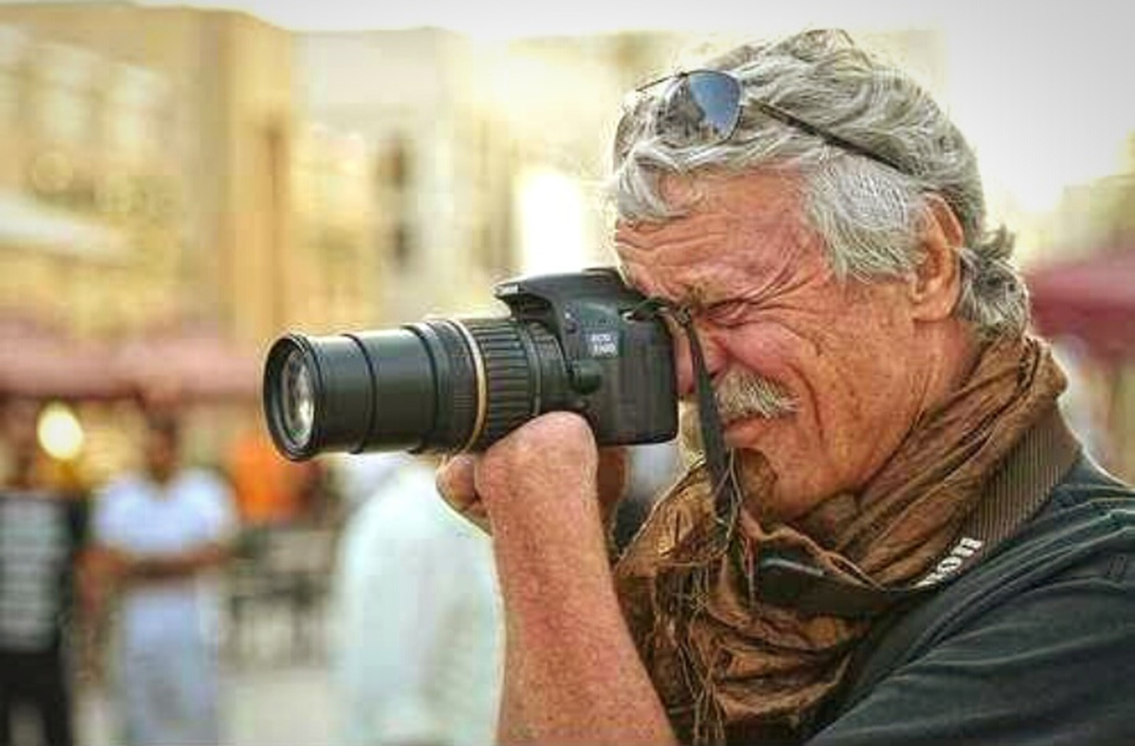 senior adult, camera - photographic equipment, men, photographing, only men, senior men, one man only, adult, one senior man only, adults only, one person, headshot, people, gray hair, day, technology, outdoors, close-up, human body part, photography themes, city