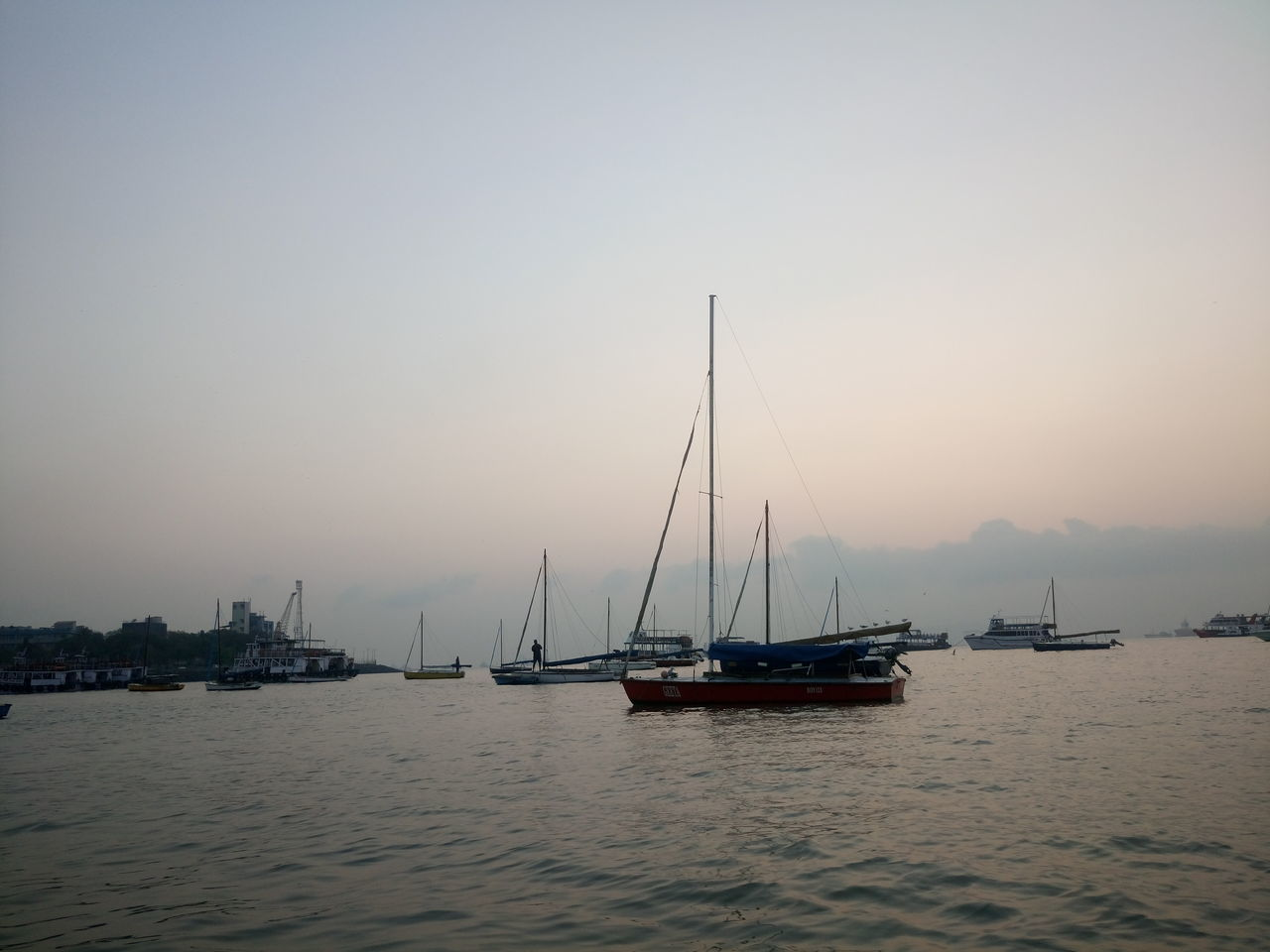 nautical vessel, water, transportation, mode of transport, mast, boat, sailboat, outdoors, nature, moored, no people, tranquility, sea, waterfront, travel destinations, harbor, scenics, sunset, tranquil scene, clear sky, sky, beauty in nature, sailing, day, yacht, architecture, sailing ship, tall ship