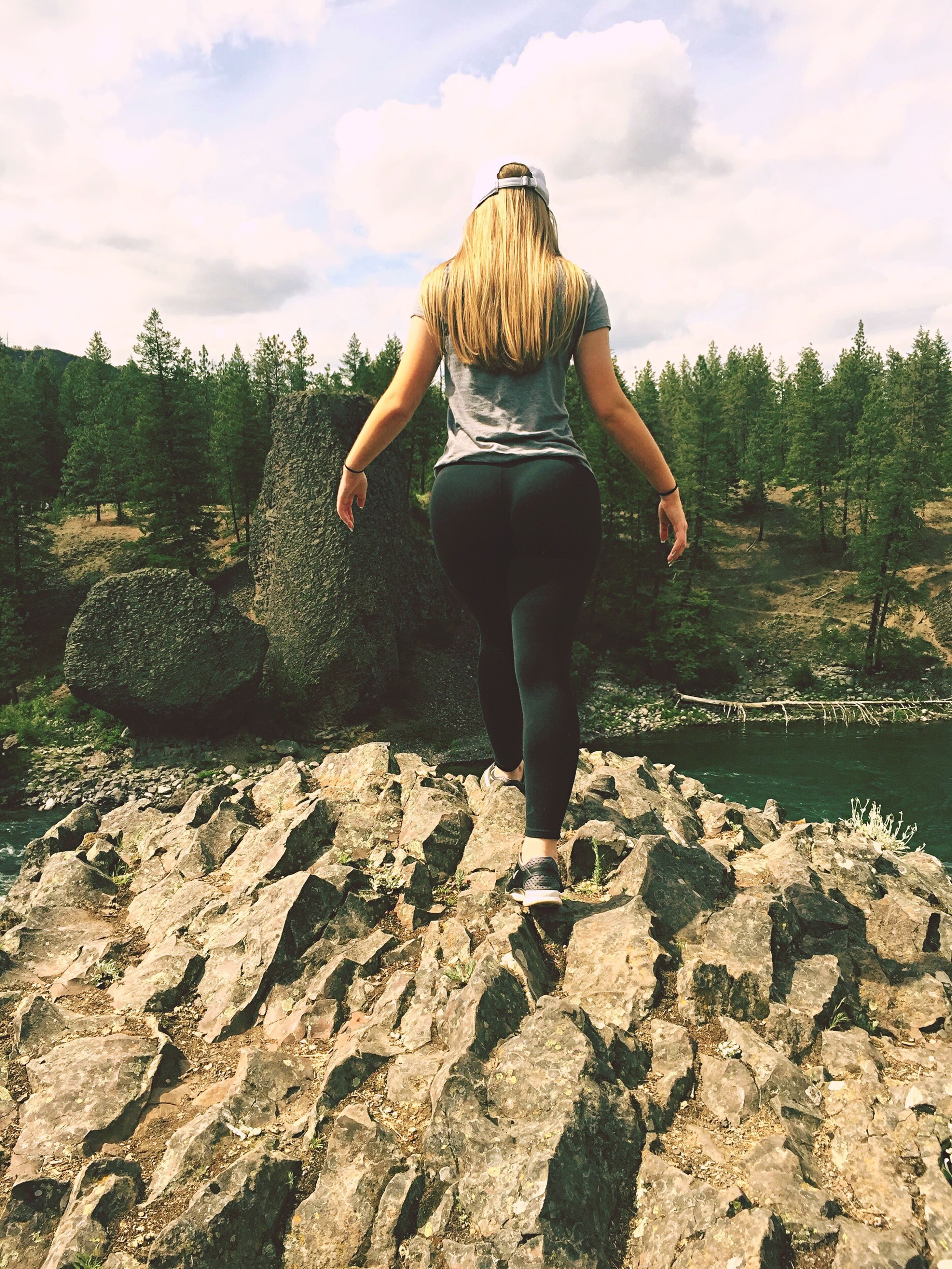 full length, sky, leisure activity, lifestyles, rear view, tranquility, tranquil scene, standing, cloud - sky, person, casual clothing, nature, scenics, beauty in nature, water, getting away from it all, tree, freedom