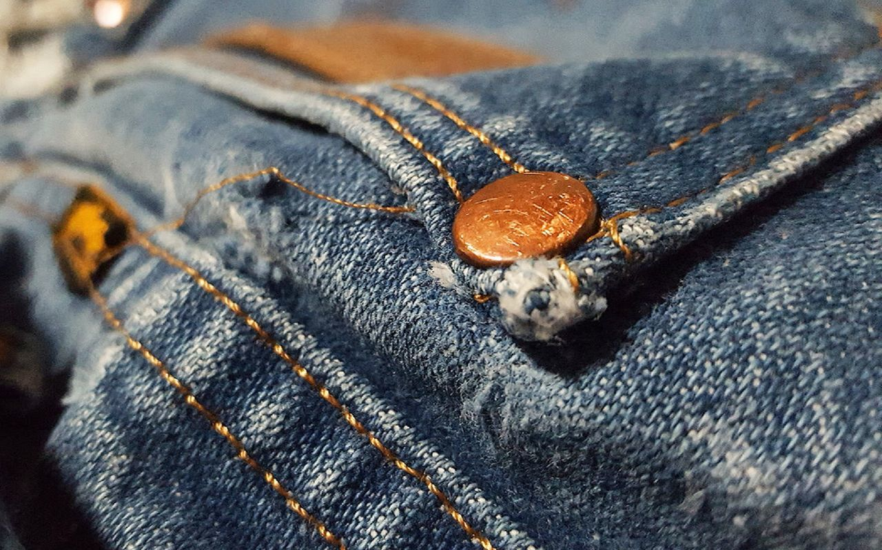 Jeans back pocket Blue Jeans Brass Rivet Close-up Day Denim Fabric Faded Material Indoors  No People Old Pair Of Jeans Stiching