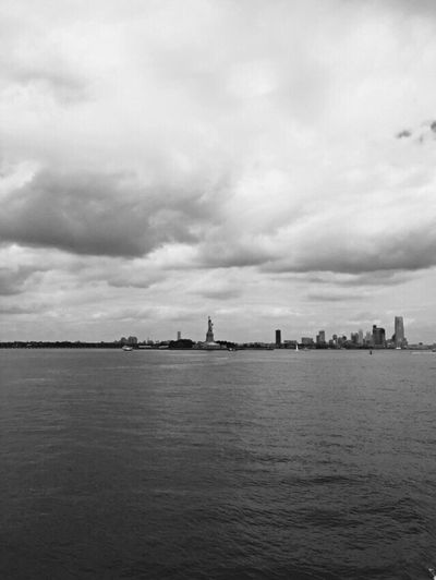 Statue of Liberty 🇺🇸🏙 Sky Water Waterfront Cloud - Sky Nature Sea Day No People Outdoors Architecture Scenics Beauty In Nature NYC New York Liberty Island Statue Of Liberty Boat Blackandwhite