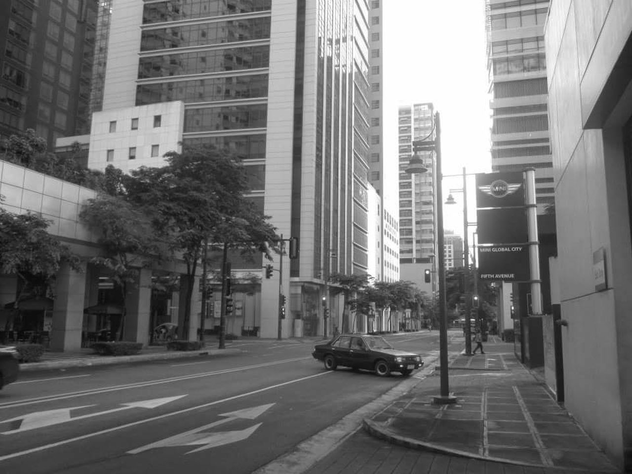 architecture, building exterior, built structure, city, street, transportation, car, city life, road, outdoors, day, land vehicle, modern, skyscraper, tree, no people