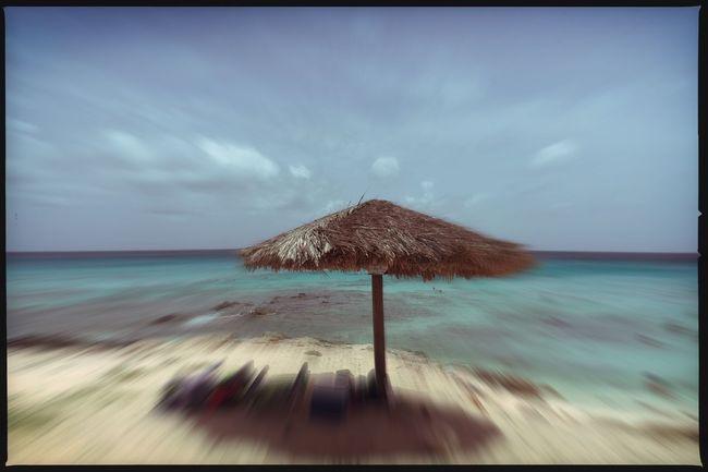 Sunday afternoon at Arashi Beach in Noord, Aruba. Aruba Beach Eye4photography  Photooftheday IPhoneography Outdoors Environment Sand Hipstamatic Pinhole EyeEm Best Shots Sky Sand
