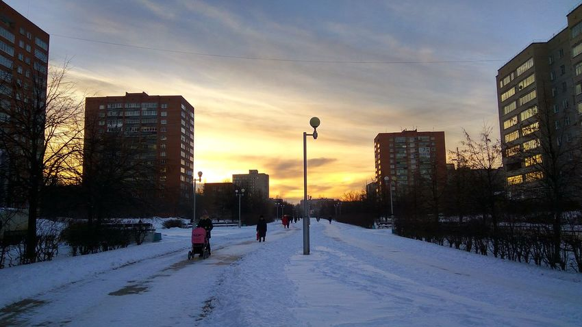 Sun snow Sunset Winter Snow Cold Temperature City City Life Urban Skyline Sky Outdoors Cityscape Beauty In Nature People Day