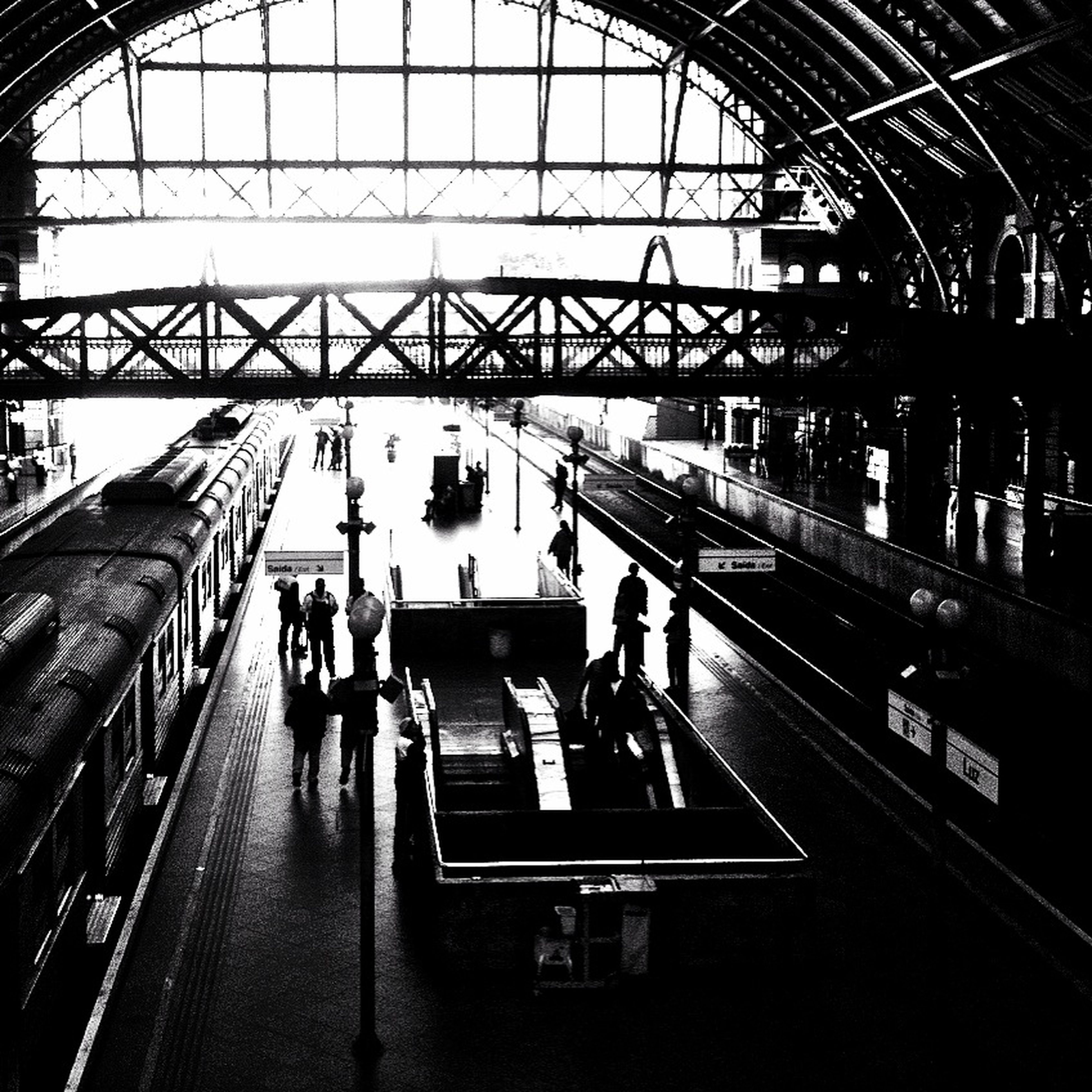 indoors, railroad station, transportation, public transportation, rail transportation, railroad station platform, large group of people, railroad track, travel, men, passenger, architecture, person, subway station, built structure, train - vehicle, transportation building - type of building, ceiling, station
