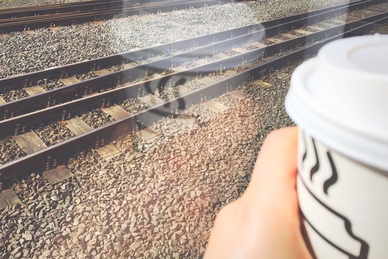 Somewhere sunny Traveling with Coffee One Person Sunlight Low Section Day Close-up Human Body Part Outdoors Reflection Window Reflections Train Public Transportation Railway EyeEm Gallery On The Road
