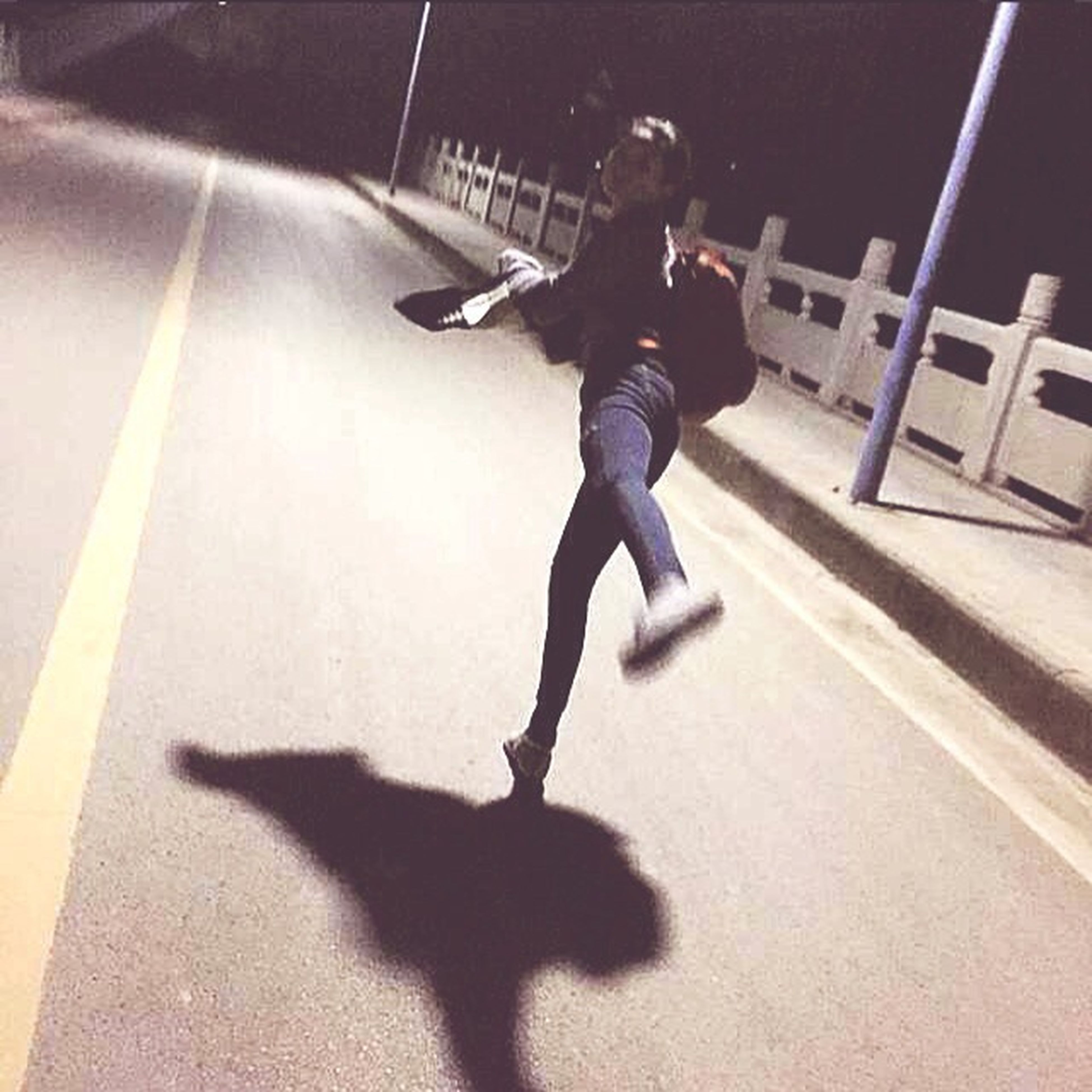 full length, lifestyles, shadow, leisure activity, childhood, sunlight, high angle view, street, jumping, elementary age, casual clothing, motion, boys, person, mid-air, fun, transportation, road