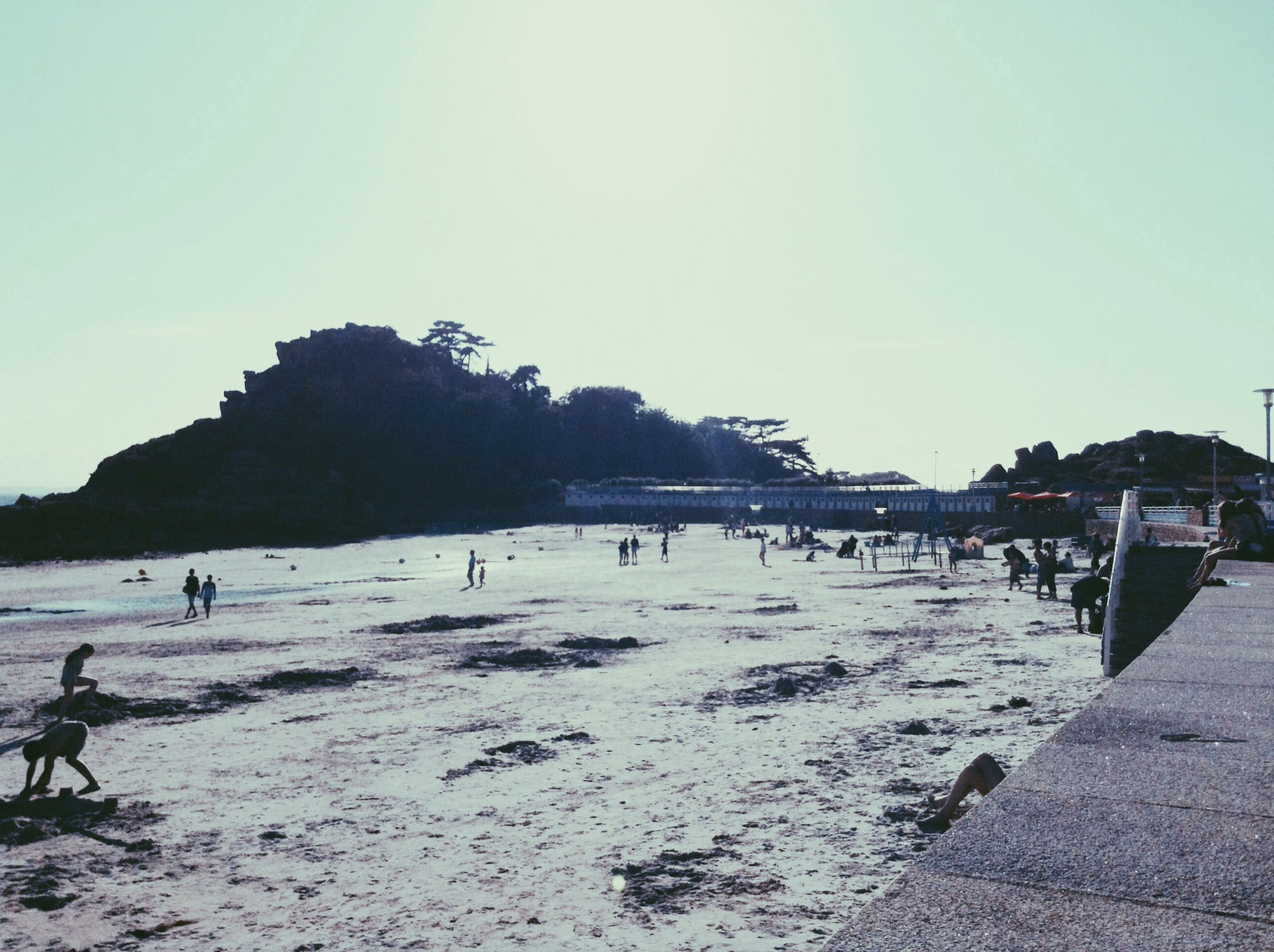 beach, large group of people, clear sky, sand, sea, shore, water, tranquil scene, vacations, scenics, tourist, copy space, tranquility, incidental people, nature, sky, mixed age range, beauty in nature, leisure activity