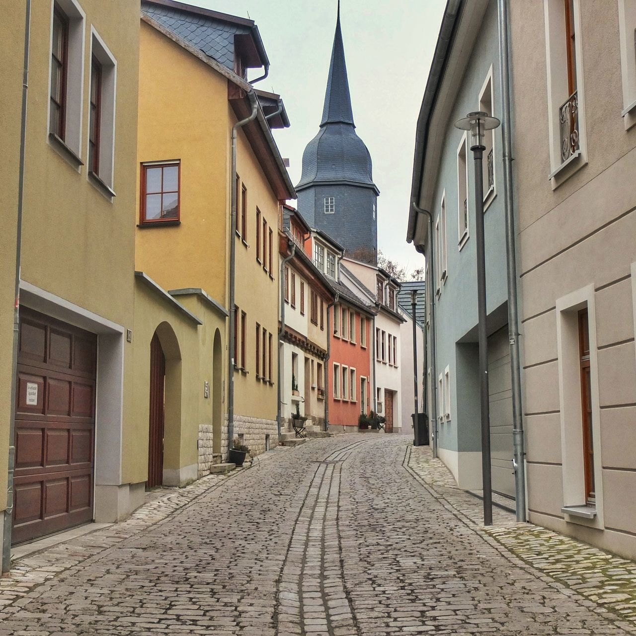 architecture, cobblestone, building exterior, built structure, no people, city, outdoors, sky, day