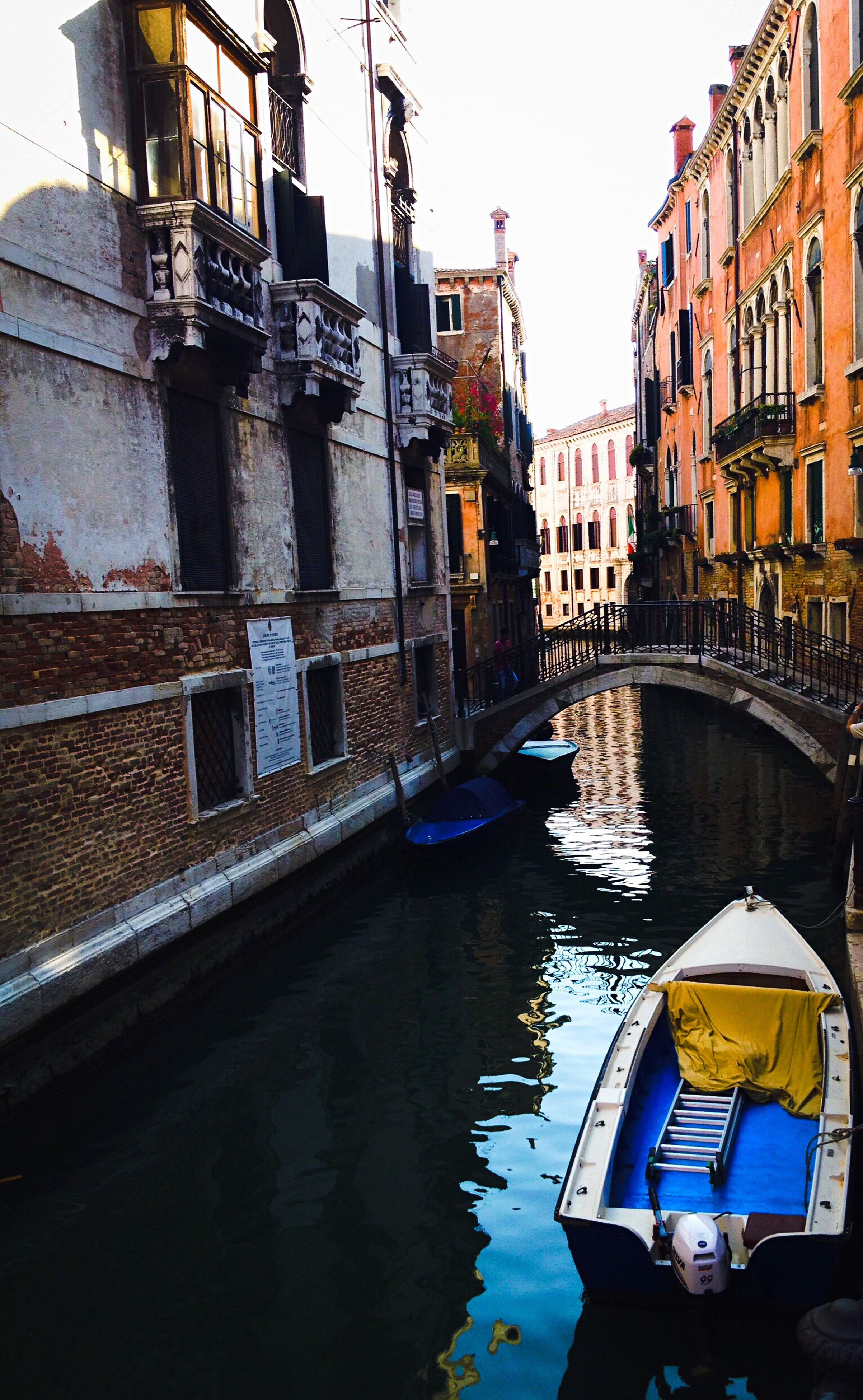 architecture, built structure, building exterior, water, nautical vessel, canal, boat, mode of transport, city, building, residential structure, residential building, day, outdoors, sky, no people, rippled, city life, travel destinations