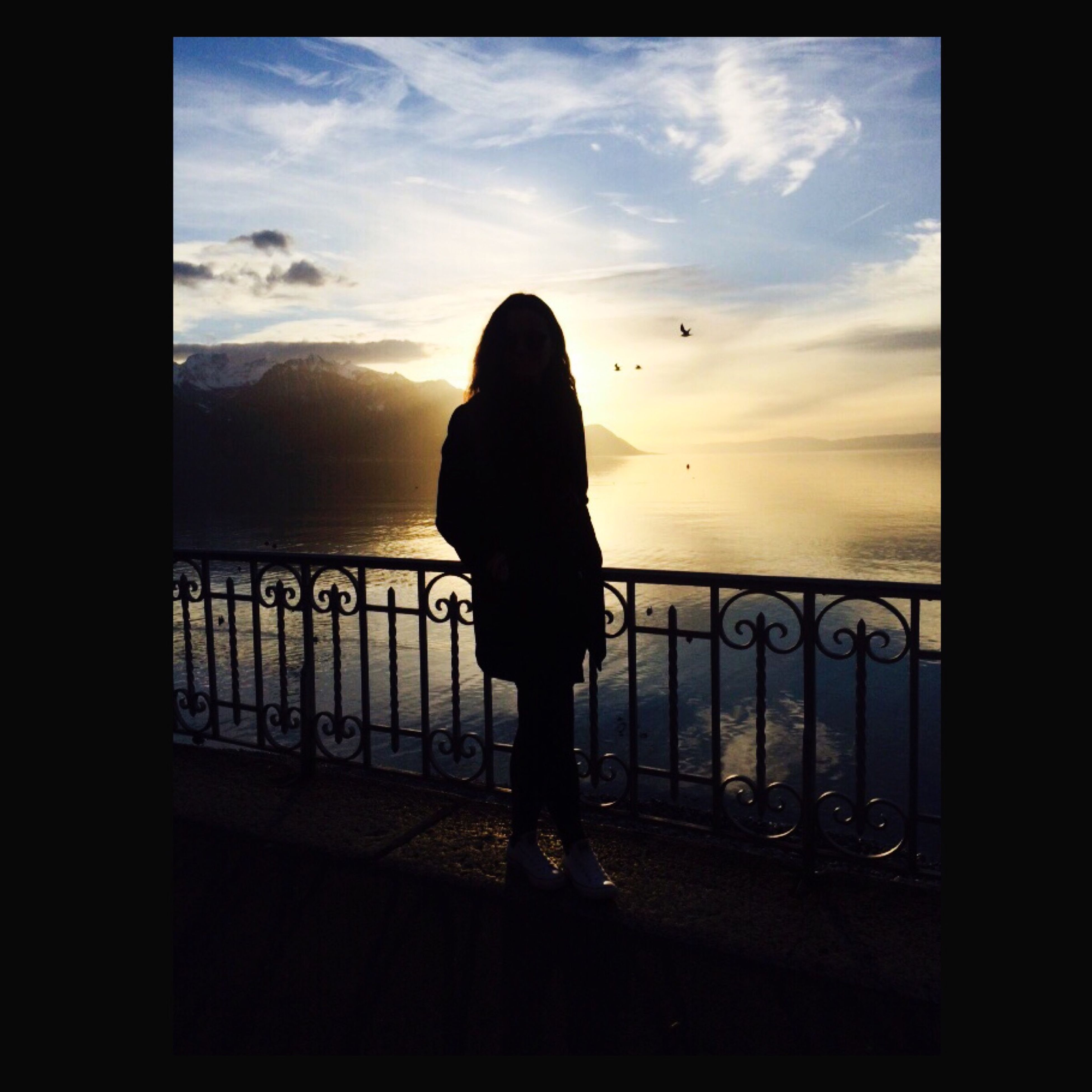 sky, silhouette, rear view, railing, sunset, sea, standing, lifestyles, full length, cloud - sky, indoors, men, leisure activity, person, water, cloud, looking at view, tranquility