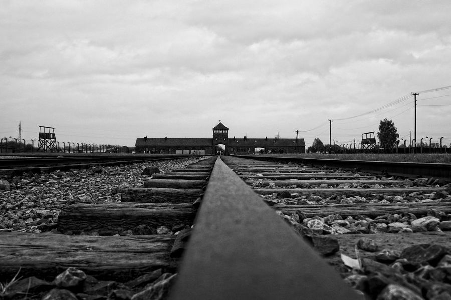 Auschwitz  Composition Concentrationcamp Day Engineering International Landmark Leading Leading Lines Long Low Angle View Outdoors Perspective Poland Rail Transportation Railroad Track Railway Track Sky Stone Straight Transportation Watchtower Ww2