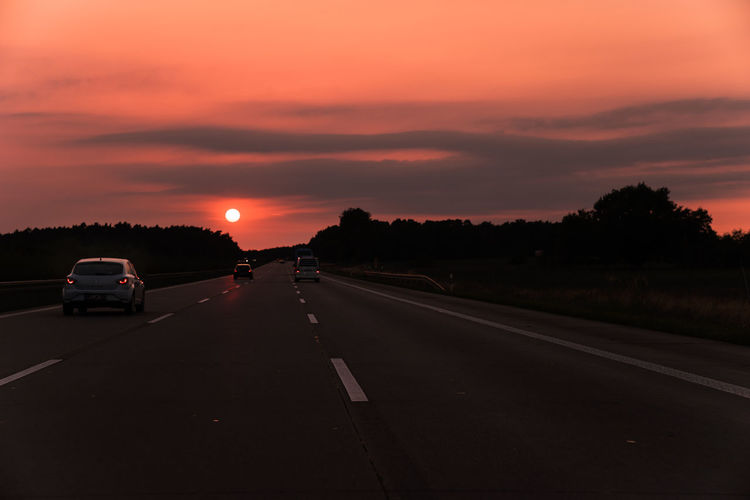 German Autobahn at sunset, Summer 2016 Autobahn Beginnings Car Country Road End Of The Day Germany Highway Journey Landstrasse On The Road Orange Color Reise Reisen Road Road Marking Roadtrip Sonnenuntergang Sunset The End The Way Forward Tomorrow Traffic Transportation Travel Verkehr