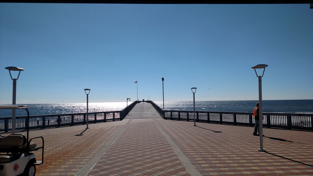 sea, water, street light, horizon over water, clear sky, day, sky, outdoors, nature, blue, no people, beauty in nature, architecture
