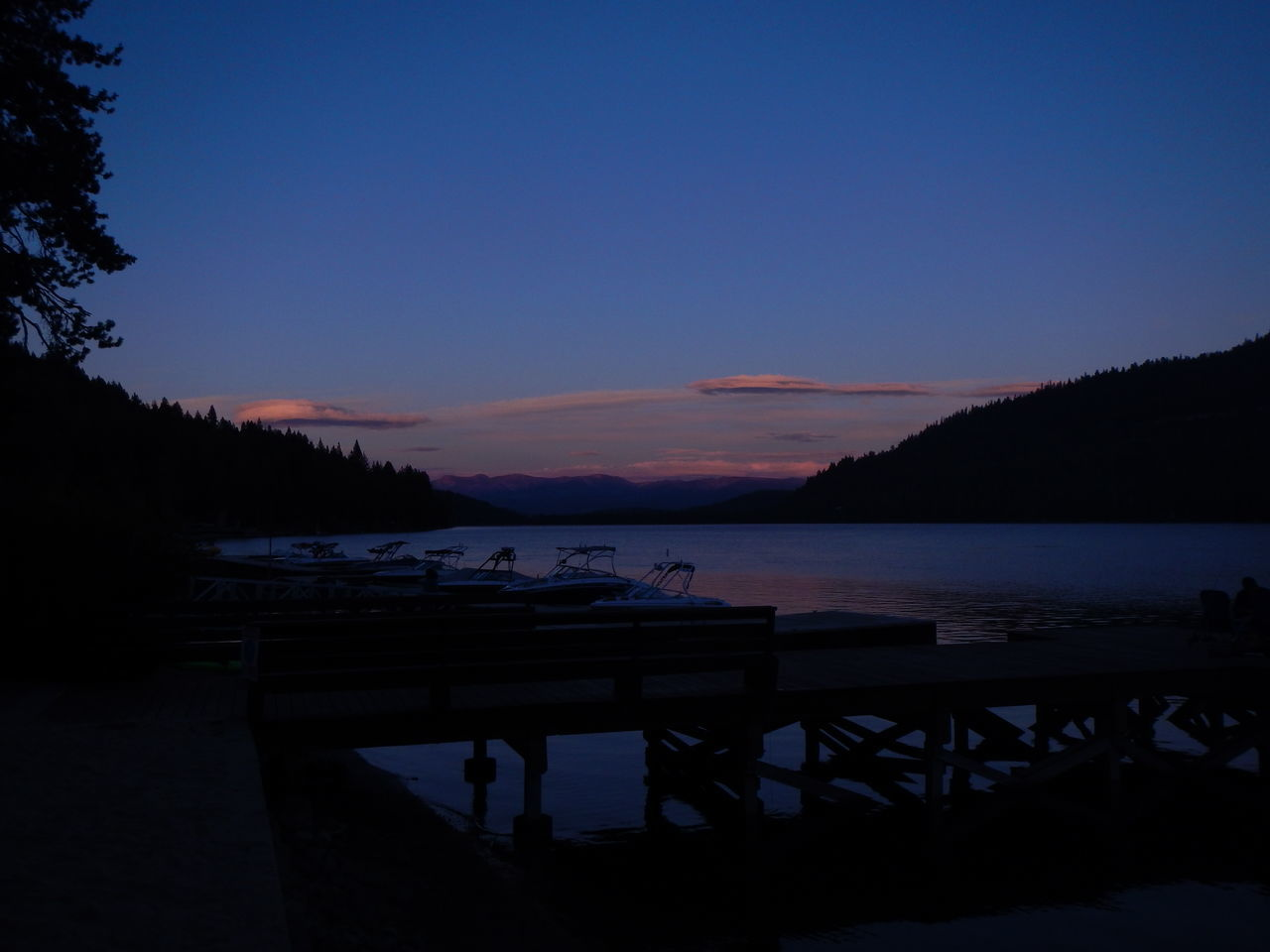 Donner Lake at dusk. View from Donner Lake Village (West Shore). Beauty In Nature Bench Blue Calm Cloud Dark Empty Idyllic Jetty Lake Lakeshore Majestic Mountain Nature Outline Pier Remote Scenics Silhouette Sky Solitude Standing Water Tranquil Scene Tranquility Water