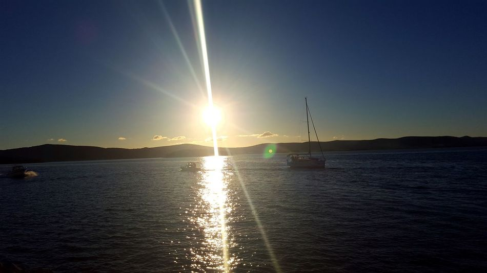 Water Beauty In Nature Clear Sky Sunset Tranquility Sea Outdoors Nature Scenics Nautical Vessel Sun Horizon Over Water Refraction Motorsport Yachting Tranquil Scene Idyllic Aquatic Sport