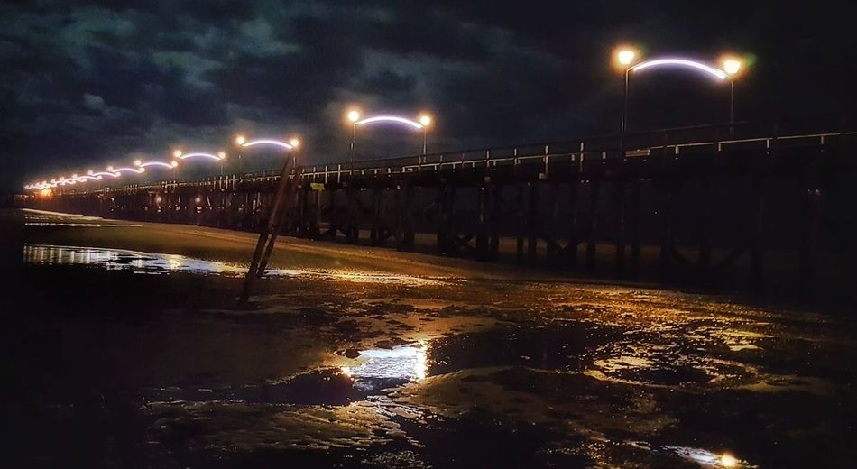 Illuminated Water Night Connection Street Light Bridge - Man Made Structure Lighting Equipment Bridge Sky Reflection River Scenics Engineering Outdoors Nature Tranquil Scene Tranquility No People Remote Non-urban Scene Built Structure Walkway Diminishing Perspective Suspension Bridge Lamp Post