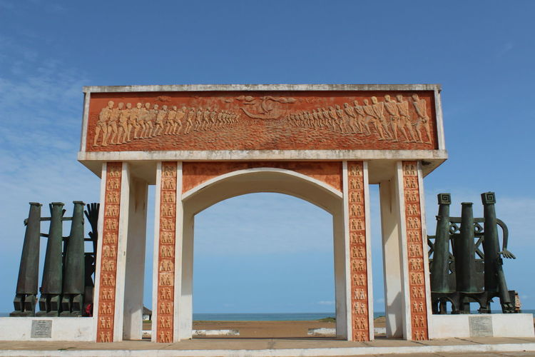 Porte du Non-Retour #History #africa #landscape #africa #streetphotography #africanlife #cotono Arch Architecture Blue Built Structure Clear Sky Day History No People Outdoors Sky Travel Destinations