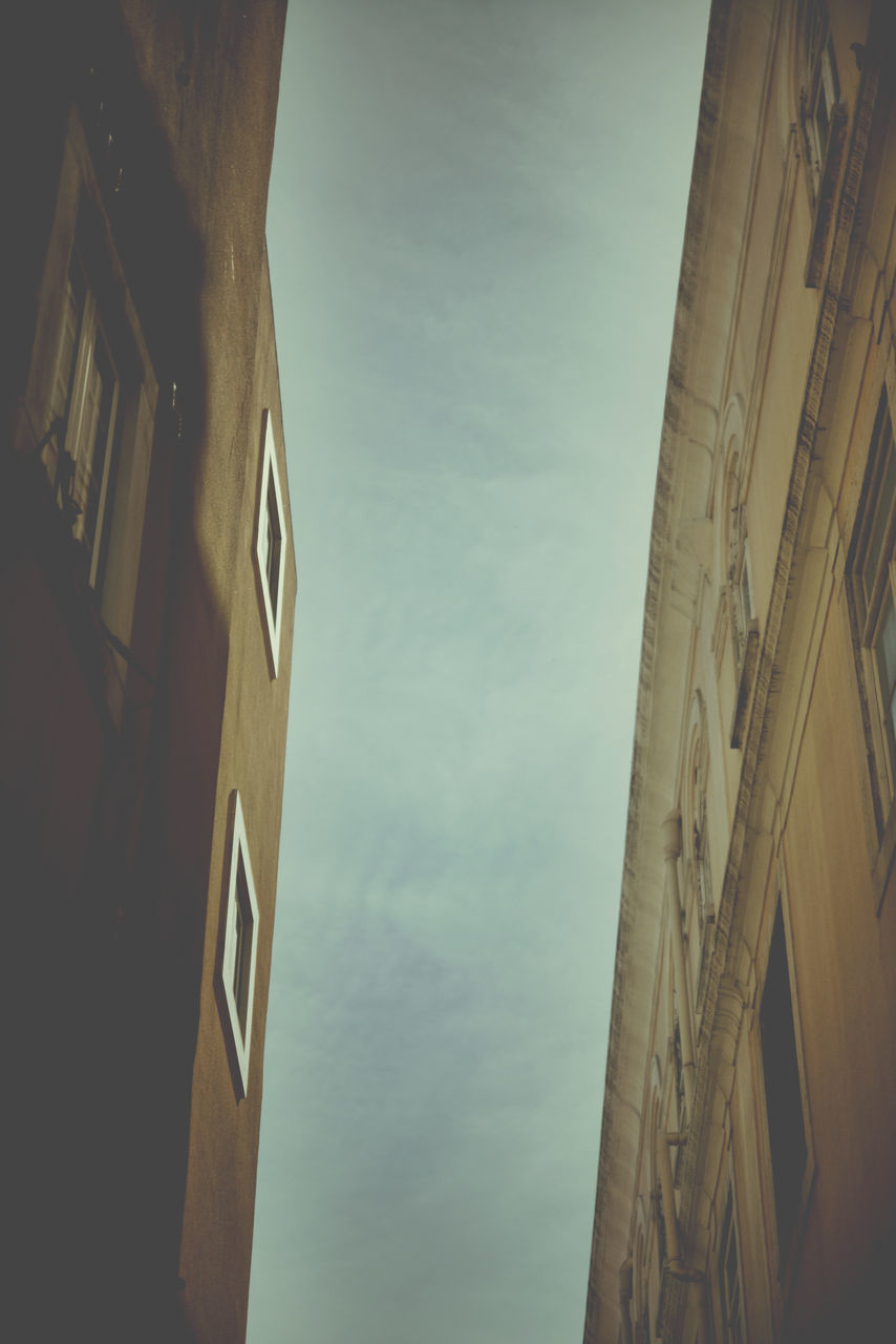 low angle view, architecture, built structure, sky, building exterior, outdoors, no people, day, nature, close-up