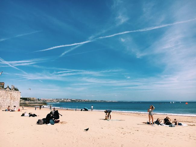 Sea Beach Sky Water Sand Large Group Of People Horizon Over Water Scenics Outdoors Building Exterior Nature Built Structure Architecture Day Leisure Activity Cloud - Sky Vacations Men Beauty In Nature