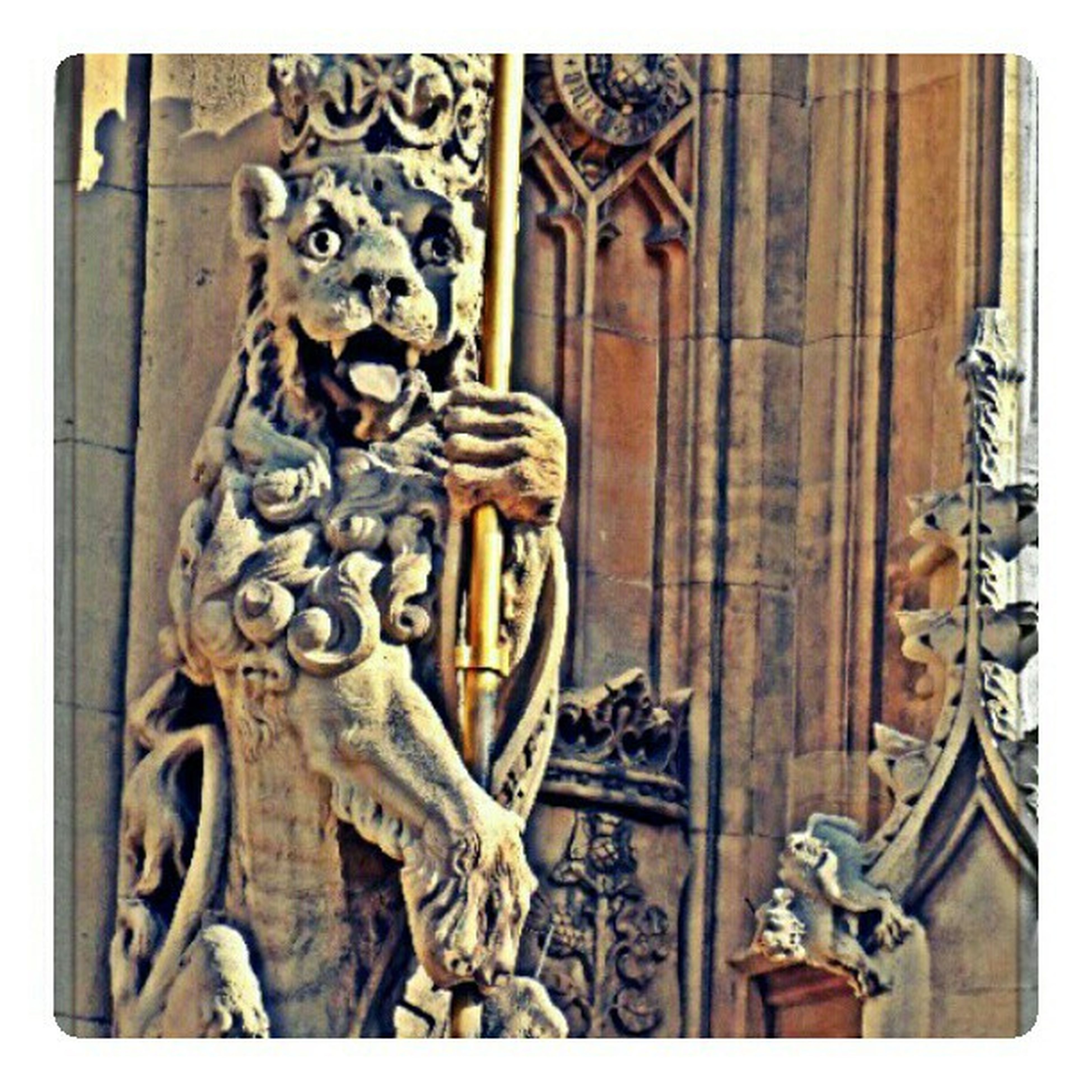 transfer print, art and craft, human representation, art, statue, auto post production filter, creativity, sculpture, carving - craft product, old, animal representation, ornate, close-up, built structure, door, religion, wall - building feature, no people
