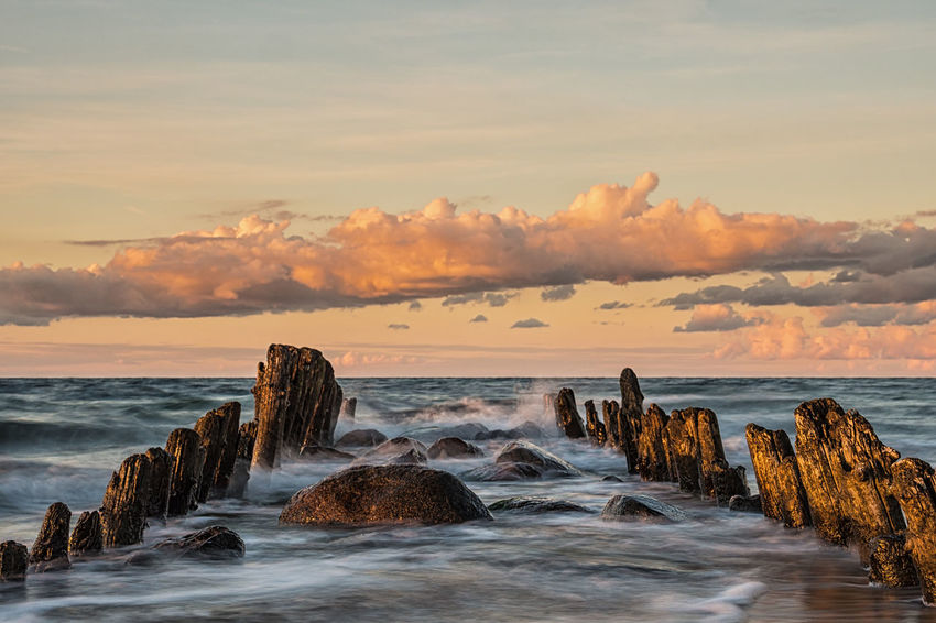 Groynes on shore of the Baltic Sea. Baltic Sea Beach Cloud - Sky Coast Day Evening Groyne Holiday Kuehlungborn Kühlungsborn Landscape Nature No People Ocean Outdoors Shore Sky And Clouds Sundown Sunset Tourism Travel Vacation Water Waves