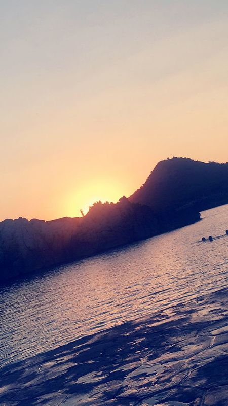 Sunset Mountain Beauty In Nature Scenics Nature Sea Tranquil Scene Water No People Clear Sky