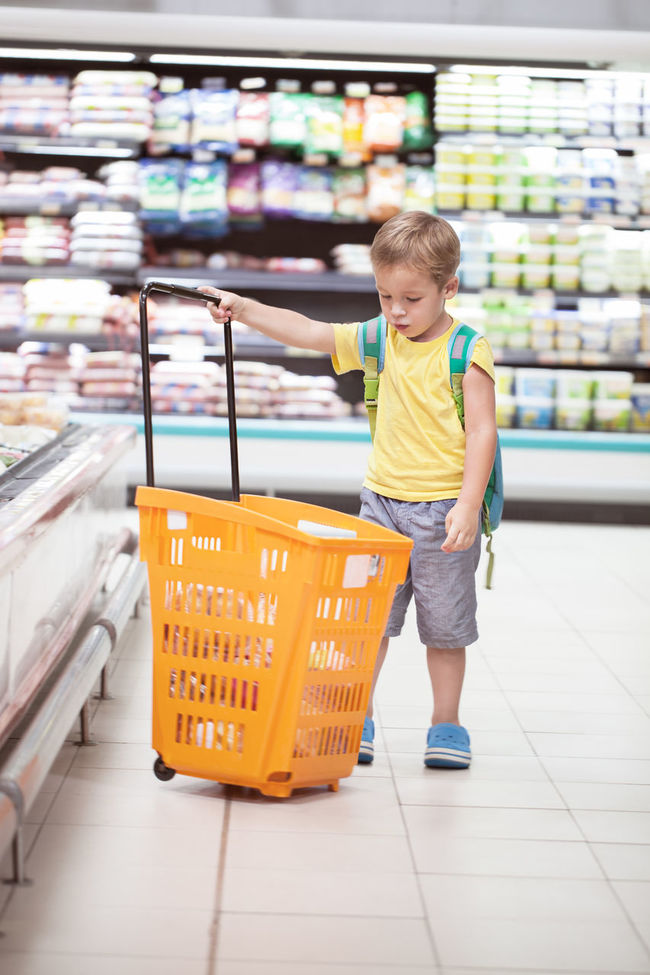 Boy Buy Cart Caucasian Child Choice Consumer Customer  Food Full Independent  Look Market Product Purchase Shop Store Supermarket Vertical