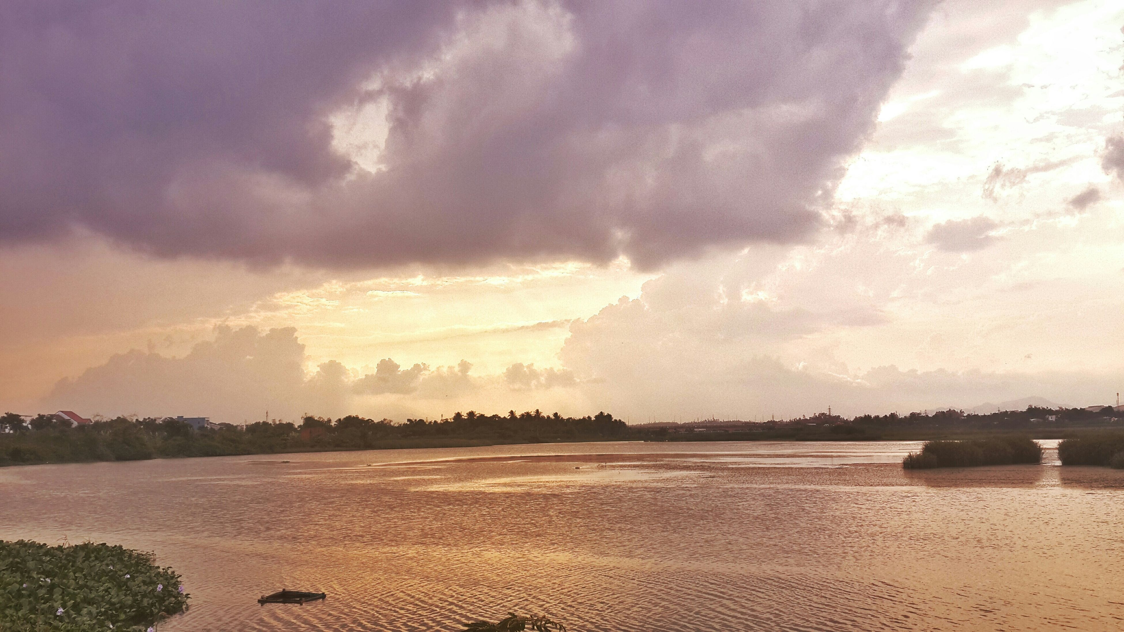 sky, water, cloud - sky, scenics, beach, tranquil scene, tranquility, beauty in nature, sea, cloudy, nature, shore, sunset, idyllic, sand, cloud, weather, outdoors, no people, dusk