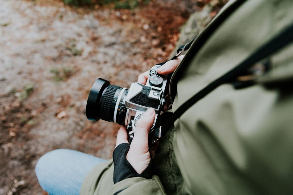Real People Lifestyles One Person Photography Themes Day Technology Leisure Activity Holding Men Outdoors Nature Close-up Human Hand One Man Only Low Section SLR Camera Lifestyle Warm Clothing Young Adult Nature Eye4photography  Check This Out Photo Camera Holding Camera