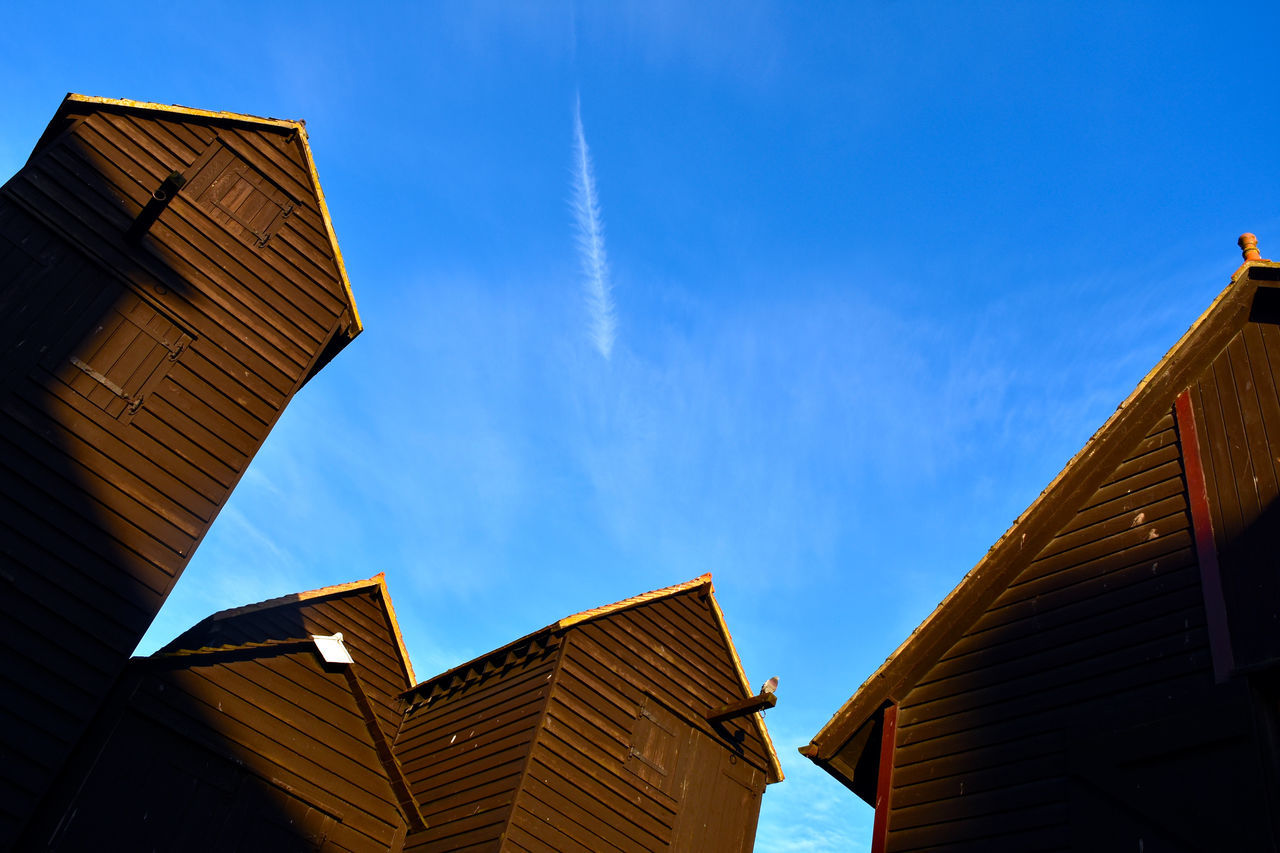 Architecture Blue Building Exterior Built Structure Clouds Clouds And Sky Day Fishing Fishing Village Low Angle View No People Outdoors Photographer Sky Vapor Trail Wooden Architecture
