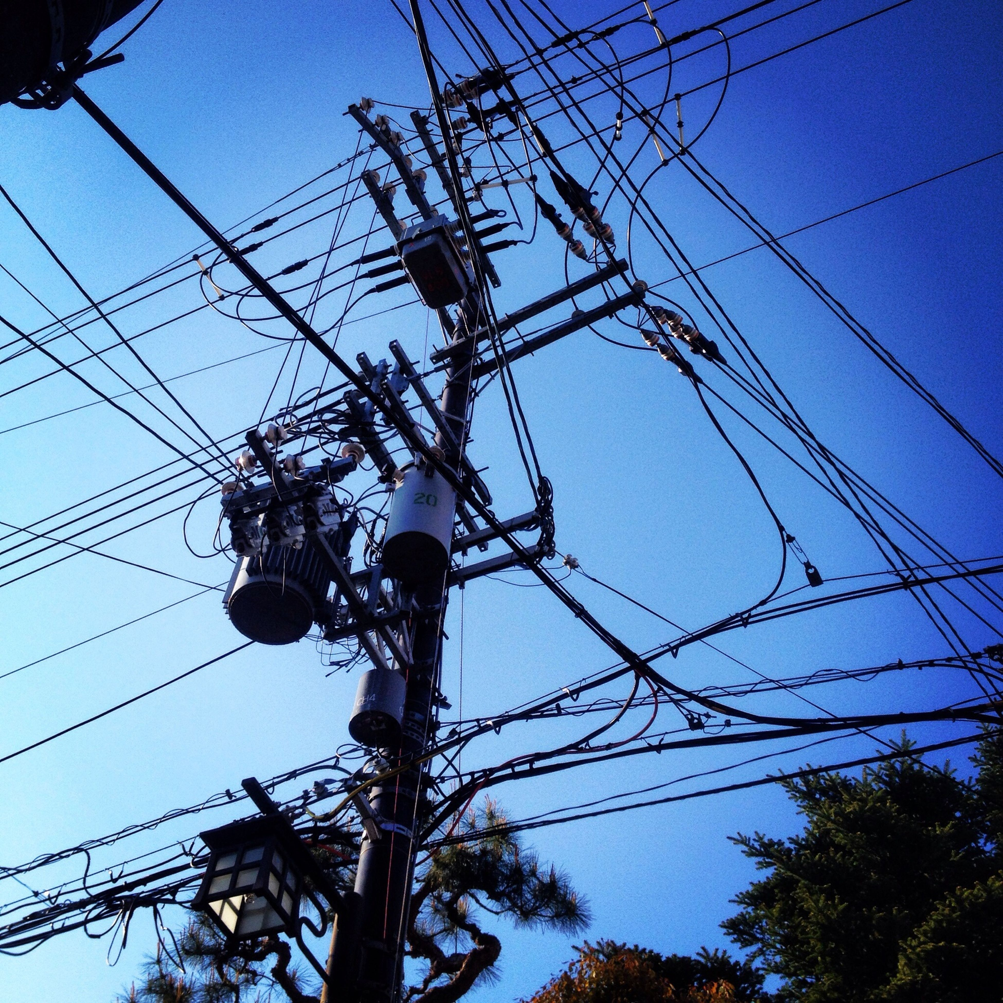 power line, low angle view, electricity, power supply, electricity pylon, cable, technology, connection, fuel and power generation, blue, clear sky, power cable, sky, complexity, lighting equipment, wire, silhouette, pole, outdoors, electricity tower