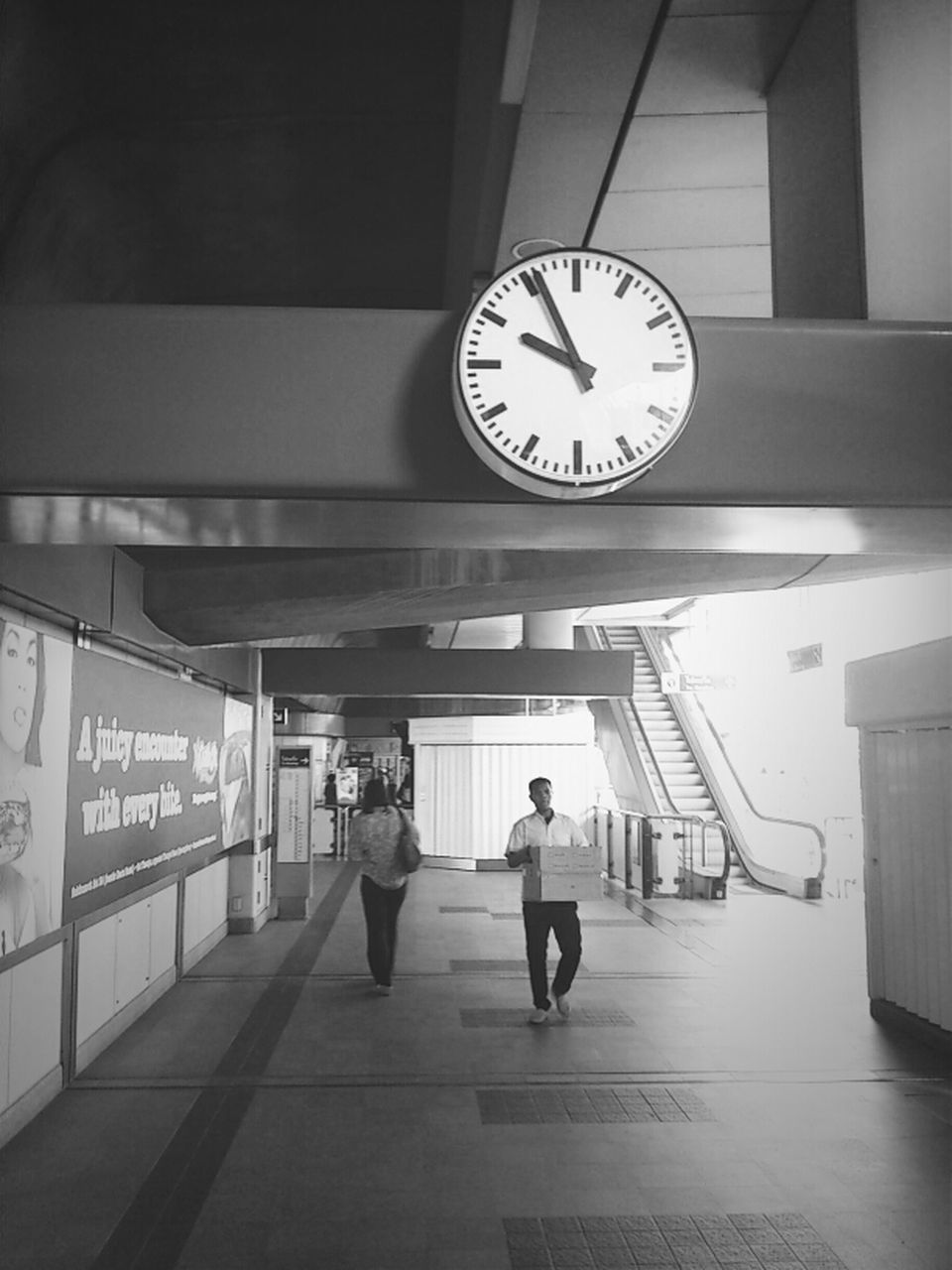 clock, time, indoors, real people, railroad station, medium group of people, men, public transportation, women, clock face, illuminated, full length, standing, minute hand, day, people