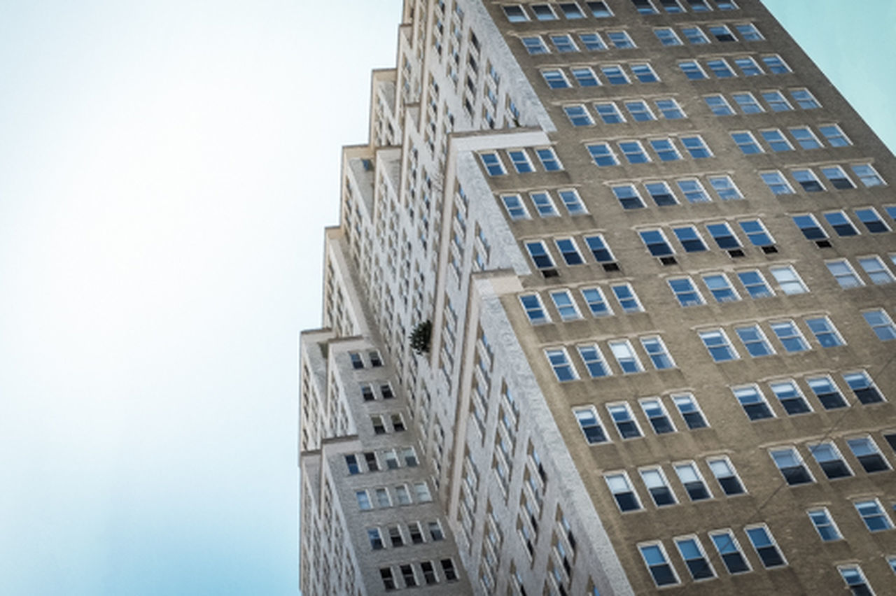 architecture, building exterior, low angle view, built structure, window, day, clear sky, outdoors, skyscraper, no people, modern, city, sky