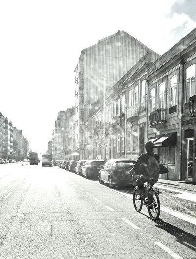 Chinese turist on bike, riding through Porto streets Bike Boavista Chinese Chinese At Porto Chinese On Bike Sunset Tourism Tourist Transportation Need For Speed