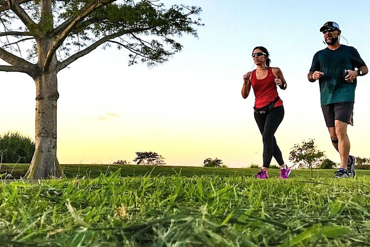Sport Healthy Lifestyle Exercising Athlete Grass Lifestyles Sports Training Outdoors Half Marathon Taking Pictures Evening Run!  Running Training Caribbean Life Low Angle View Puerto Rico Perseverance People Nature Dusk Synchronized Cadence Endurance Togetherness