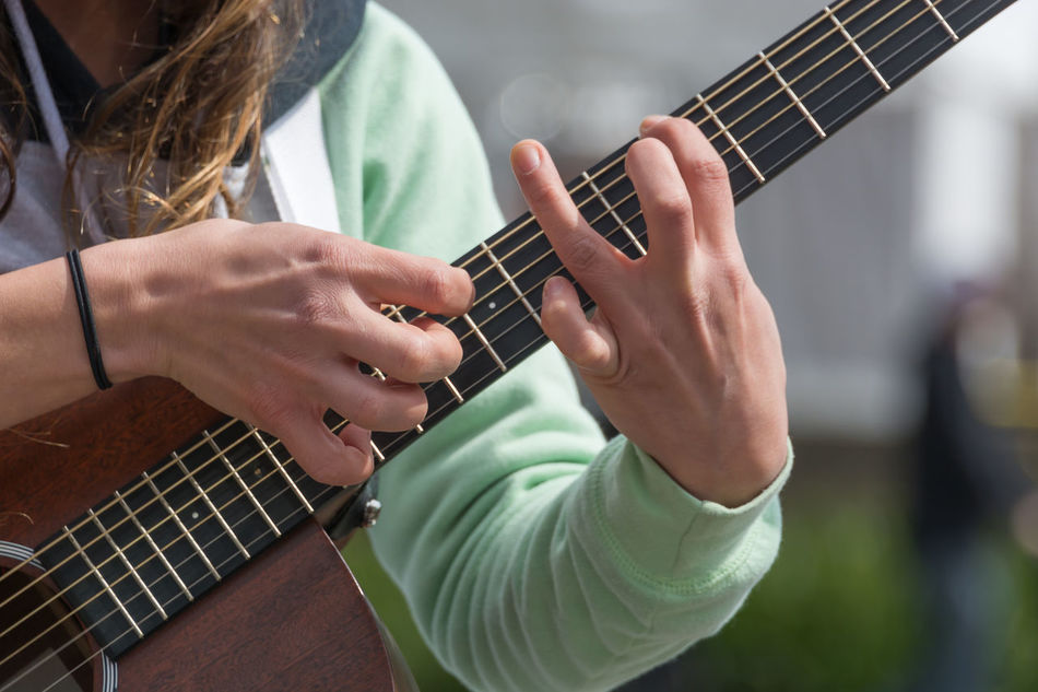 Adult Adults Only Classical Guitar Close-up Day Guitar Guitarist Human Body Part Human Hand Leisure Activity Lifestyles Men Music Musical Instrument Musical Instrument String Musician People Playing Plucking An Instrument Skill  String Instrument Two People Women Young Adult Young Women