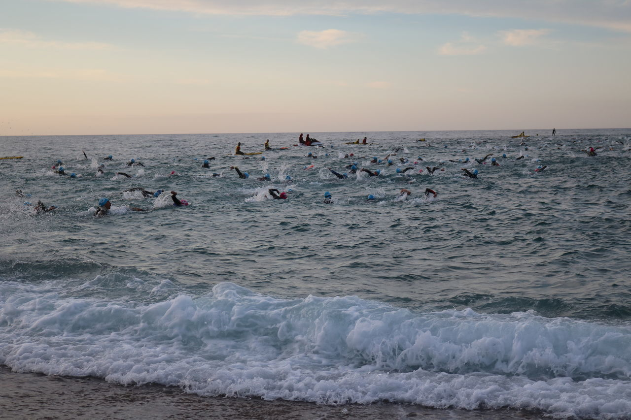 Rough seas for the start of Ironman Barcelona 70.3 70.3 Barcelona, Spain Beach Beauty In Nature Coordination Day Horizon Over Water Ironman Large Group Of People Outdoors People Sand Sea Sky Sunset Swimming TRIATHLON Water Wave